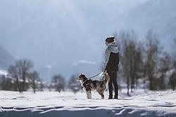 THEMENBILD - eine Jugendliche mit ihrem Hund beim Gassi gehen am Winterwanderweg, aufgenommen am 10. Januar 2021 in Zell am See, Oesterreich // A teenager with her dog walking on the winter hiking trail in Zell am See, Austria on 2021/01/10. EXPA Pictures © 2021, PhotoCredit: EXPA/ JFK