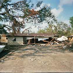 A house sits in the middle of a road following the devastation left in the aftermath of Hurricane Katrina that flooded the small city of Buras, Louisiana in Plaquemines Parish on August 29, 2005. ..(Mandatory Credit: Photo by Derick E. Hingle)