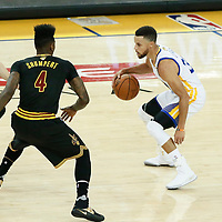 12 June 2017: Cleveland Cavaliers guard Kyle Korver (26) and Cleveland Cavaliers guard Iman Shumpert (4) defend on Golden State Warriors guard Stephen Curry (30) during the Golden State Warriors 129-120 victory over the Cleveland Cavaliers, in game 5 of the 2017 NBA Finals, at the Oracle Arena, Oakland, California, USA.