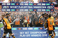 Hull City players celebrate as they lift the Sky Bet Championship Playoff Trophy .Skybet football league Championship play off final match, Hull city v Sheffield Wednesday at Wembley Stadium in London on Saturday 28th May 2016.<br /> pic by John Patrick Fletcher, Andrew Orchard sports photography.