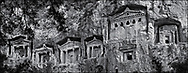 Sacred Stone - Black and white photo art print of Hellenistic rock temple fronted Tombs of Kaunos by Paul Williams. The Hellenistic rock temple fronted Tombs of Kaunos,  4th - 2nd cent. B.C , just outside the archaeological site of Kounos on the oposite side of the Calbys river from Dalyan, Turkey.