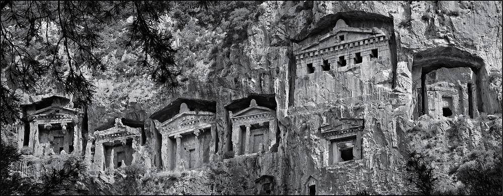 Sacred Stone - Black and white photo art print of Hellenistic rock temple fronted Tombs of Kaunos by Paul Williams. The Hellenistic rock temple fronted Tombs of Kaunos,  4th - 2nd cent. B.C , just outside the archaeological site of Kounos on the oposite side of the Calbys river from Dalyan, Turkey. .<br /> <br /> Visit our LANDSCAPE PHOTO ART PRINT COLLECTIONS for more wall art photos to browse https://funkystock.photoshelter.com/gallery-collection/Places-Landscape-Photo-art-Prints-by-Photographer-Paul-Williams/C00001WetsxVxNTo