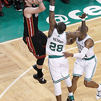 03 June 2012: Miami Heat shooting guard Mike Miller (13) takes a jumpshot over Boston Celtics small forward Mickael Pietrus (28) and Boston Celtics shooting guard Ray Allen (20) during the Boston Celtics 93-91 overtime victory over the Miami Heat, in Game 4 of the Eastern Conference Finals playoff series, at the TD Banknorth Garden, Boston, Massachusetts, USA.