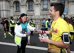 A volunteer handouts snacks after the 2018 London Landmarks Half Marathon. PRESS ASSOCIATION Photo. Picture date: Sunday March 25, 2018. Photo credit should read: John Walton/PA Wire