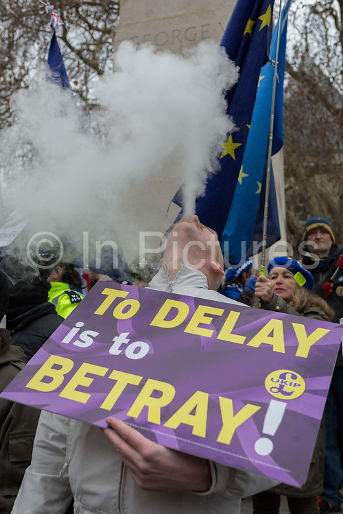 On the day that the UK Parliament once again votes on an amendment of Prime Minister Theresa Mays Brexit deal that requires another negotiation with the EU in Brussels, a far-right pro-Remain vapes among pro-EU protesters gather outside the House of Commons, on 29th January 2019, in Westminster, London, England.