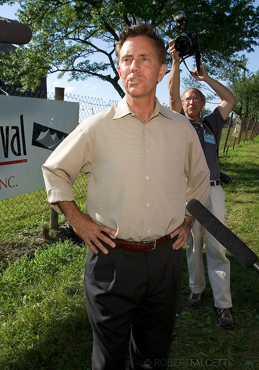 GOSHEN, CT - AUGUST 5:  Greenwich, CT businessman Ned Lamont talks to the media outside the gate of the Litchfield Jazz Festival August 5, 2006 in Goshen, Connecticut. Lamont and his supporters including actor Danny Glover and California Congreeswoman Mazine Waters were first told they would not be allowed to enter the festival by organizer Vita Muir. Muir later said they could enter and enjoy the jazz, but not campaign. Lamont is in a heated race for the Connecticut democratic nomination for Senate against Sen. Joe Lieberman. (Photo by Bob Falcetti/Getty Images)