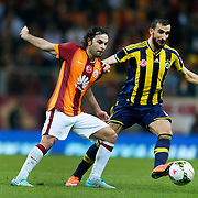 Galatasaray's Selcuk Inan (L) and Fenerbahce's Mehmet Toplal (R) during their Turkish superleague soccer derby match Galatasaray between Fenerbahce at the AliSamiYen spor kompleksi TT Arena in Istanbul Turkey on Saturday, 18 october 2014. Photo by Aykut AKICI/TURKPIX