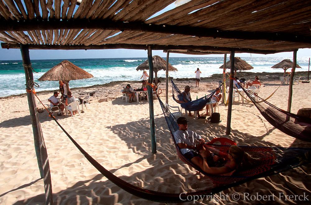 MEXICO, COZUMEL, TOURISM beach palapas at Paradise Café
