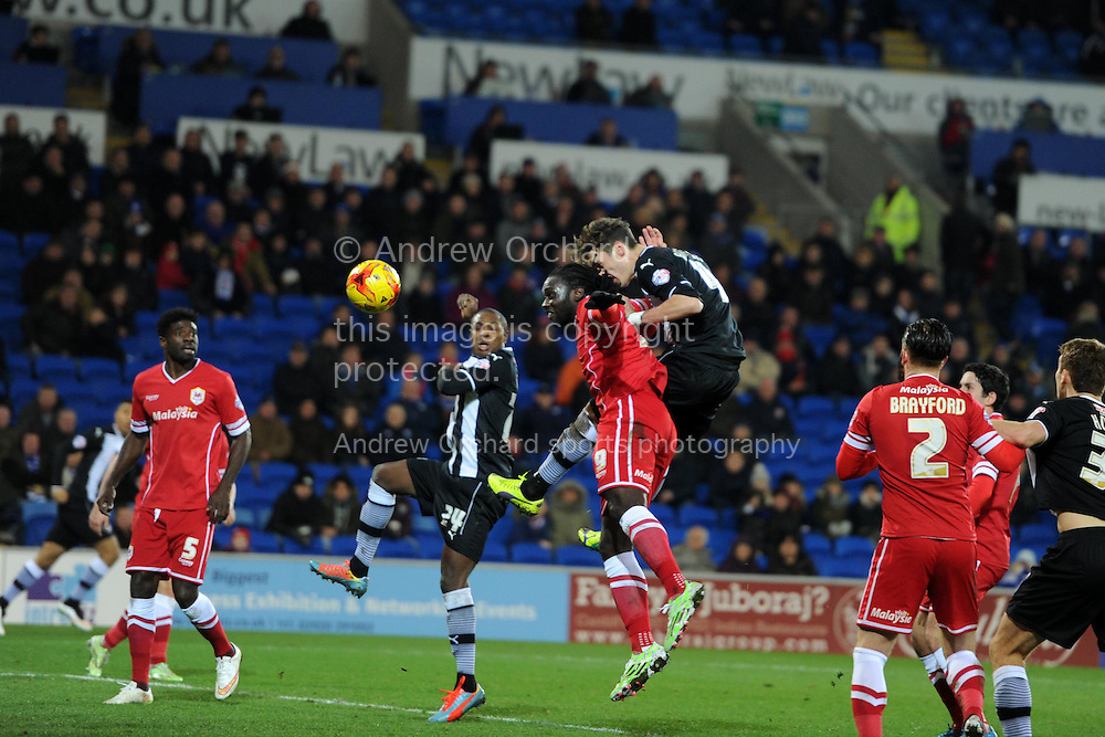 Watford 's Gabriele Angella © scores  his teams 4th goal with a header  to make it 1-4.  Skybet football league championship match, Cardiff city v Watford at the Cardiff city stadium in Cardiff, South Wales on Sunday 28th December 2014<br /> pic by Andrew Orchard, Andrew Orchard sports photography.