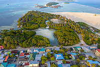 Aerial view of local island Huraa, North Malé Atoll, Maldives, Indian Ocean with reclaimed land, mangroves and overwatervillas in the distance