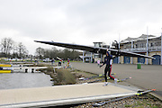 Eton, GREAT BRITAIN,  Sculler carries boat, GB Trials 3rd Winter assessment at,  Eton Rowing Centre, venue for the 2012 Olympic Rowing Regatta, Trials cut short due to weather conditions forecast for the second day Saturday  12/02/2011   [Photo, Peter Spurrier/Intersport-images]