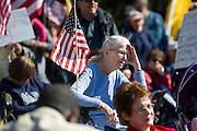 Joyce Hasper listens to the speakers during the 'Day of resistance' anti-Obama protest event at Flag Pole Hill on Saturday, February 23, 2013 in Dallas, Texas. (Cooper Neill/The Dallas Morning News)