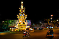 """Most Thai towns have a clock tower that marks the center of the city which are useful for both the time and an orientation point. This majestic landmark puts on a """"show"""" every night at 9 o'clock, changing colors and become one of Chiang Rai's favorite tourist attractions. The Chiang Rai Clocktower was built to honour his majesty King Bhumibol Adulyadej."""