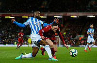 Huddersfield Town's Isaac Mbenza battles with Liverpool's Andrew Robertson<br /> <br /> Photographer Alex Dodd/CameraSport<br /> <br /> The Premier League - Liverpool v Huddersfield Town - Friday 26th April 2019 - Anfield - Liverpool<br /> <br /> World Copyright © 2019 CameraSport. All rights reserved. 43 Linden Ave. Countesthorpe. Leicester. England. LE8 5PG - Tel: +44 (0) 116 277 4147 - admin@camerasport.com - www.camerasport.com