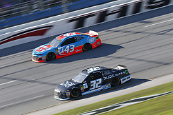 October 14, 2018 - Talladega, Alabama, United States of America - Matt DiBenedetto (32) battles for position during the 1000Bulbs.com 500 at Talladega Superspeedway in Talladega, Alabama. (Credit Image: © Justin R. Noe Asp Inc/ASP via ZUMA Wire)
