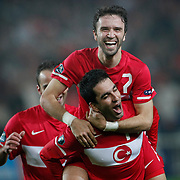 Turkey's Gokhan GONUL (C) celebrates his goal with a teammate during their UEFA EURO 2012 Qualifying round Group A soccer match Turkey between Austria at Sukru Saracoglu stadium in Istanbul March 29, 2011. Photo by TURKPIX