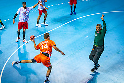 The Dutch handball player Bobby Schagen and Yunus Ozmusul in action during the European Championship qualifying match against Turkey in the Topsport Center Almere.