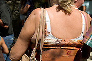 obese middle aged woman seen from behind