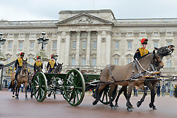© Licensed to London News Pictures. 06/02/2013. London, UK The Troop passes Buckingham Palace. The King's Troop Royal Horse Artillery, wearing immaculately presented full dress uniform, provide a colourful spectacle as they ride past Buckingham Palace today, 6th February 2013, to Green Park to stage a 41 Gun Royal Salute marking the 61st Anniversary of the Accession of Her Majesty The Queen. Photo credit : Stephen Simpson/LNP
