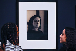 © Licensed to London News Pictures. 19/11/2019. LONDON, UK. Staff members view a portrait of Dora Maar, c1937, by Rogi Andre. Preview of the first UK retrospective of Dora Maar (born Henriette Theodora Markovitch, 1907-97) whose photographs and photomontages became celebrated icons of surrealism.  Over 200 of her works are on display in a career spanning more than six decades at Tate Modern 20 November to 15 March 2020.  Photo credit: Stephen Chung/LNP