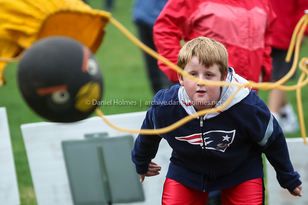 (10/22/16, HUDSON, MA) Joe Farrell, 8, of Hudson, launches a rubber ball at the Angry Birds game during the 19th annual Pumpkin Fest at the Morgan Bowl in Hudson on Saturday. Daily News and Wicked Local Photo/Dan Holmes