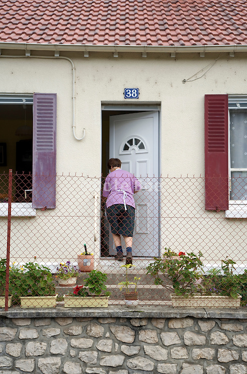 woman entering her house