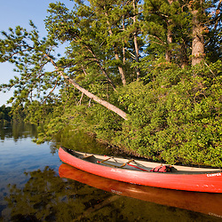 A canoe on the shore of White Lake at White Lake State Park in Tamworth, New Hampshire.