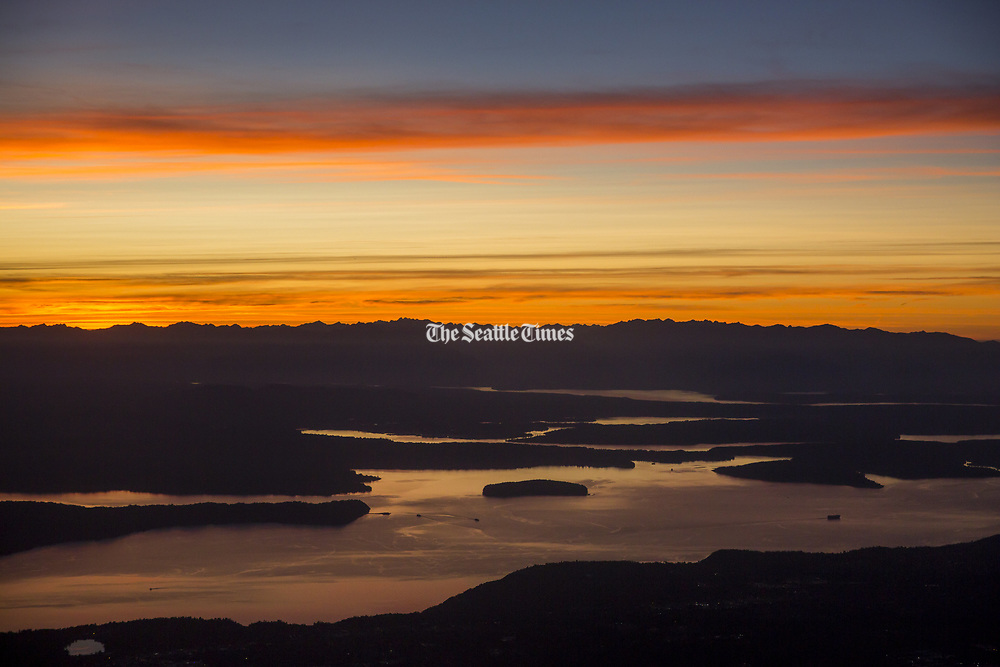 The view over Puget Sound from an inbound airline flight. (Bettina Hansen / The Seattle Times)