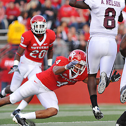 Oct 10, 2009; Piscataway, NJ, USA; Rutgers cornerback David Rowe (4) attempts to tackle Texas Southern quarterback Arvell Nelson (8) during first half NCAA college football action between Rutgers and Texas Southern at Rutgers Stadium.