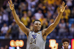 Mar 7, 2020; Morgantown, West Virginia, USA; West Virginia Mountaineers forward Oscar Tshiebwe (34) celebrates after a play during the first half against the Baylor Bears at WVU Coliseum. Mandatory Credit: Ben Queen-USA TODAY Sports