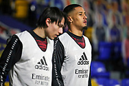Arsenal defender William Saliba (4) warming up prior to kick offduring the EFL Trophy match between AFC Wimbledon and U21 Arsenal at Plough Lane, London, United Kingdom on 8 December 2020.