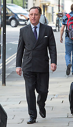 Image ©Licensed to i-Images Picture Agency. 04/07/2014. London, United Kingdom. Neville Thurlbeck arrives for sentence. Former journalist of the News of the World Neville Thurlbeck arrives today for sentencing in the phone hacking trial at Old Bailey. Picture by Daniel Leal-Olivas / i-Images