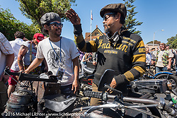 Shinya Kimura with teammate Yoshimasa Nimi as he rides over the finish in Carlsbad, CA on his Team-80 1915 Indian twin during the Motorcycle Cannonball Race of the Century. Stage-15 ride from Palm Desert, CA to Carlsbad, CA. USA. Sunday September 25, 2016. Photography ©2016 Michael Lichter.