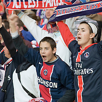 11 March 2007: Two young supporters of the french soccer team Paris Saint-Germain (PSG) Football Club hold a banner of the PSG prior to the French League 1 football game won 1-0 by AJ Auxerre FC over Paris Saint-Germain (PSG) at the Parc des Princes stadium, in Paris, France.