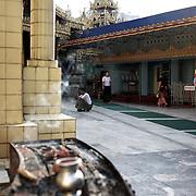 May 09, 2013 - Yangon, Myanmar: A devotee prays at Sule Pagoda in central Yangon. (Paulo Nunes dos Santos/Polaris)