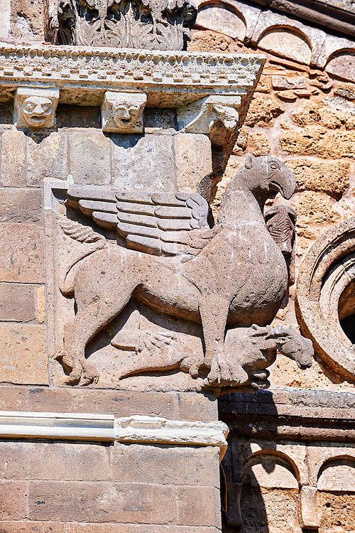 13th century winged griffin on the 8th century Romanesque Basilica church of St Peters, Tuscania, Lazio, Italy .<br /> <br /> Visit our ITALY PHOTO COLLECTION for more   photos of Italy to download or buy as prints https://funkystock.photoshelter.com/gallery-collection/2b-Pictures-Images-of-Italy-Photos-of-Italian-Historic-Landmark-Sites/C0000qxA2zGFjd_k