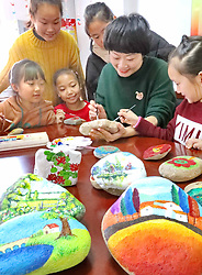 January 31, 2018 - Qinhuangdao, Qinhuangdao, China - Qinhuangdao,CHINA-31st January 2018: Pupils draw beautiful paintings on stones in Qinhuangdao, north China's Hebei Province, appealing the public to pay attention to environmental protection. (Credit Image: © SIPA Asia via ZUMA Wire)