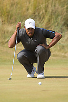 Golf - 2013 Open Championship at Muirfield - Saturday Round Three<br /> Tiger Woods of USA lines up a putt on the 3rd