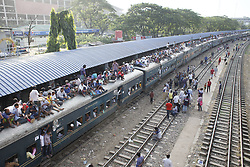 August 29, 2017 - Dhaka, Bangladesh - Bangladeshi homebound people sit on top of train as they head to their hometowns ahead of the Muslim holiday of Eid al-Adha, in Dhaka, Bangladesh. (Credit Image: © Suvra Kanti Das via ZUMA Wire)