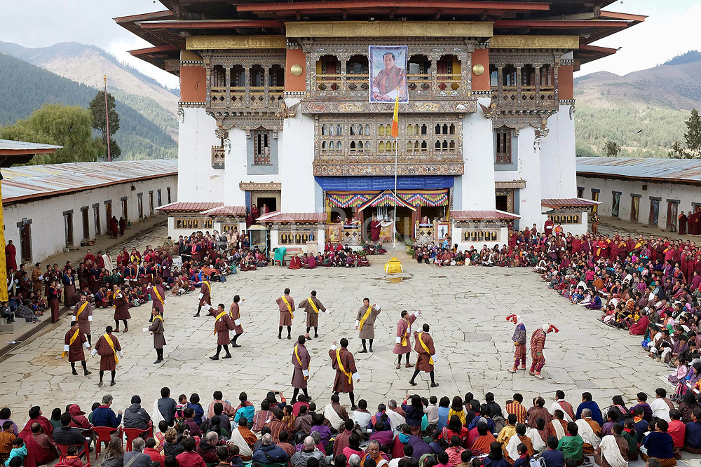Traditional Bhutanese dancing at the Black-necked Crane festival at Gangte Goemba, Phobjikha Valley, Bhutan. Every year on November 11th, the local community hosts the Black-necked Crane festival at Gangte Goemba, to highlight its significance to the valley. Phobjikha Valley is the most significant overwintering ground of the rare and endangered Black-necked Crane in Bhutan.