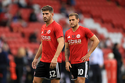Sheffield United's Ched Evans (left) and Sheffield United's Billy Sharp warming up before the Carabao Cup, Second Round match at Bramall Lane, Sheffield.