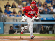 The Angels' Albert Pujols throws his bat after grounding out to third in the first inning against the Dodgers during their Freeway Series game Friday night at Dodger Stadium.<br /> <br /> <br /> ///ADDITIONAL INFO:   <br /> <br /> freeway.0402.kjs  ---  Photo by KEVIN SULLIVAN / Orange County Register  --  4/1/16<br /> <br /> The Los Angeles Angels take on the Los Angeles Dodgers at Dodger Stadium during the Freeway Series Friday.<br /> <br /> <br />  4/1/16