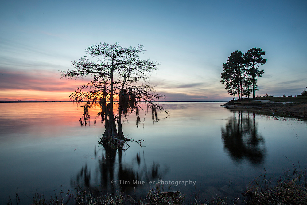 Sunset near the 17th-hole at Cypress Bend Golf Resort and Conference Center. The Toledo Bend Forest Scenic Byway on Louisiana Highway 191 starts at the reservoir dam, goes north through Sabine Parish and ends 20-miles into DeSoto Parish at Logansport and Hwy 84.