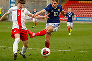 Kai Kennedy (Rangers FC) gets a shot blocked during the U17 European Championships match between Scotland and Poland at Firhill Stadium, Maryhill, Scotland on 26 March 2019.