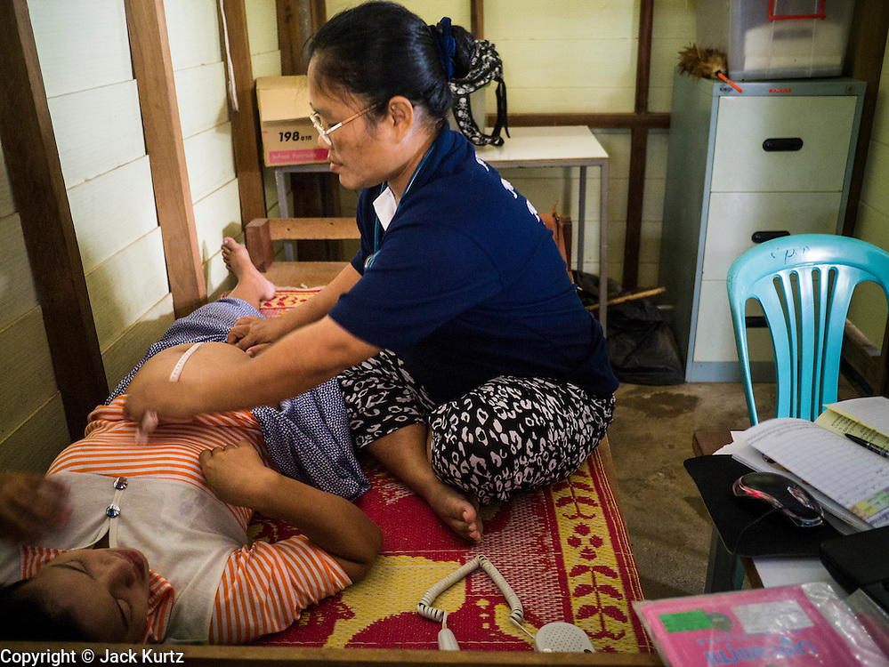 21 MAY 2013 - MAE KU, TAK, THAILAND:  A health care worker does a prenatal examine on a Burmese woman at the SMRU clinic in Mae Ku, Thailand. Health professionals are seeing increasing evidence of malaria resistant to artemisinin coming out of the jungles of Southeast Asia. Artemisinin has been the first choice for battling malaria in Southeast Asia for 20 years. In recent years though,  health care workers in Cambodia and Myanmar (Burma) are seeing signs that the malaria parasite is becoming resistant to artemisinin. Scientists who study malaria are concerned that history could repeat itself because chloroquine, an effective malaria treatment until the 1990s, first lost its effectiveness in Cambodia and Burma before spreading to Africa, which led to a spike in deaths there. Doctors at the Shaklo Malaria Research Unit (SMRU), which studies malaria along the Thai Burma border, are worried that artemisinin resistance is growing at a rapid pace. Dr. Aung Pyae Phyo, a Burmese physician at a SMRU clinic just a few meters from the Burmese border, said that in 2009, 90 percent of patients were cured with artemisinin, but in 2010, it dropped to about 70 percent and is now between 55 and 60 percent. He said the concern is that as it becomes more difficult to clear the parasite from a patient, progress that has been made in combating malaria will be lost and the disease could make a comeback in Southeast Asia.  PHOTO BY JACK KURTZ