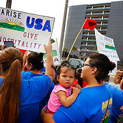 Izabella Robles, 1, is held by relative Mary Ann Aldape as she attends a rally supporting President Obama's executive action on immigration in front Bentsen Tower, which houses the Southern District of the U.S. Federal District Court, in McAllen. The United States Supreme Court heard oral arguments in the case that could defer deportation of millions of people living in the United States. <br /> Nathan Lambrecht/The Monitor