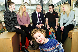 Pictured: Four year old Theo LaCroix photobombed Mr Swinney as he met modern apprentices Kayleigh Singer (grey jumper); Georeg McArthur (pink jumper), Holly Whitehead (black and white dress) and Jake Stefanovic, an ambassador from the Scottish Government's childcare recruitment campaign.<br /> Deputy First Minister John Swinney visited Cowgate Nursery in Edinburgh to meet children, staff and modern apprentices working in early years and childcare. Mr Swinney confirmed that a record number of early years apprenticeships are expected to start this year as part of the expansion of free nursery and childcare.  Mr Swinney toured the nursery and discussed the City of Edinburgh Council's plans to expand the early years and childcare workforce and met with modern apprentices as well as Jake Stefanovic, an ambassador from the Scottish Government's childcare recruitment campaign.<br /> <br /> <br /> Ger Harley | EEm 13 February 2018