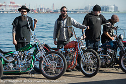 Mooneyes guest custom builders from the USA (L>R) Ryan Grossman, Max Schaaf, Chopper Dave Frestonchopp and Steve Caballero at the Yokohama docks where their bikes were unloaded prior to the Mooneyes Yokohama Hot Rod & Custom Show. Yokohama, Japan. December 3, 2016.  Photography ©2016 Michael Lichter.