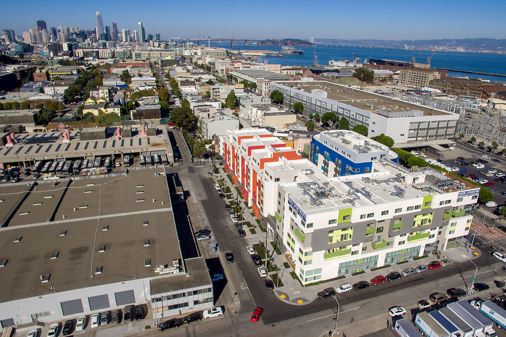 in the Dogpatch neighborhood on Thursday, Oct. 26, 2017, in San Francisco, Calif. With three major housing complexes opening at once, the population of the neighborhood is set to nearly double in the next few months, bringing vitality to the streets but raising questions about whether the newcomers will create traffic gridlock, overcrowded buses and overrun open spaces.
