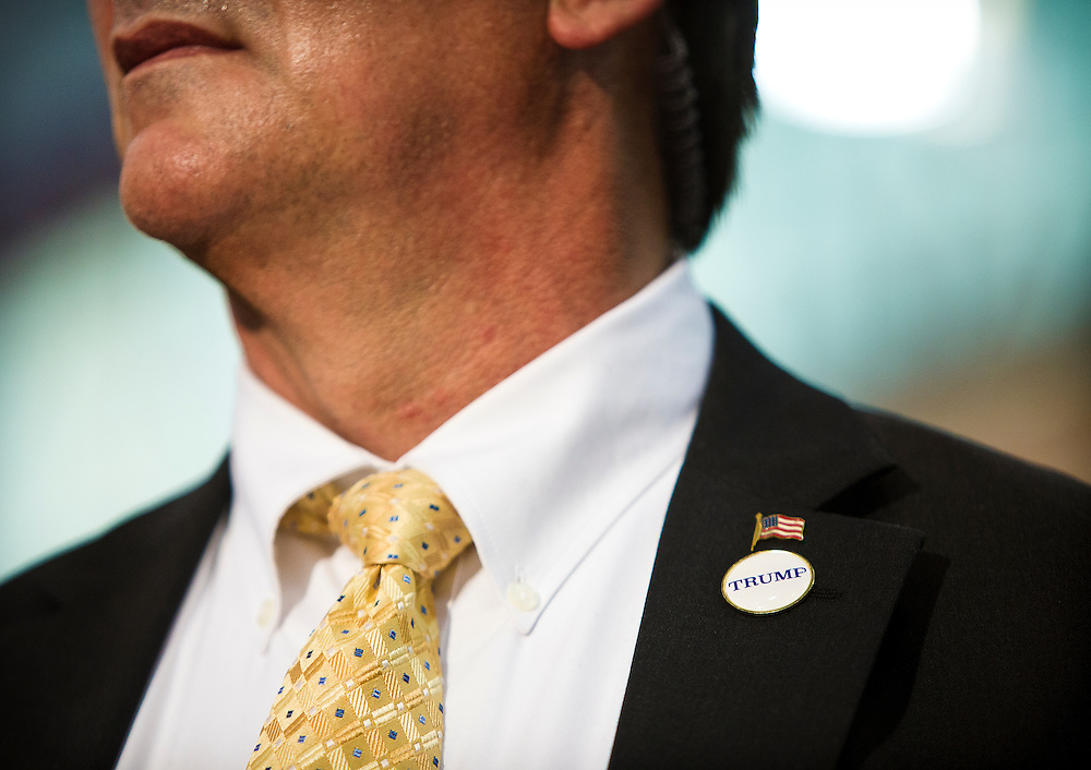"""A Donald Trump body guard's flag and """"Trump"""" pin during the candidate's """"Make America Great Again Rally"""" at the Grand River Center in Dubuque, Iowa, Tuesday, August 25, 2015. REUTERS/Ben Brewer"""